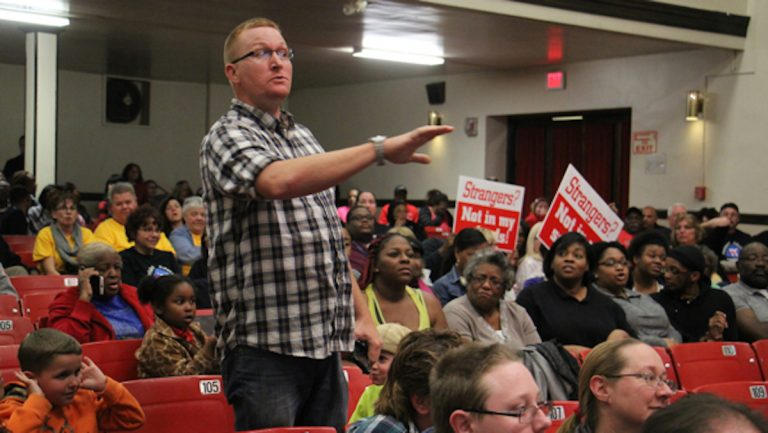 Scott Hurst, father of two young children in the Paulsboro school district, speaks out at a school board budget meeting. (Emma Lee/WHYY)