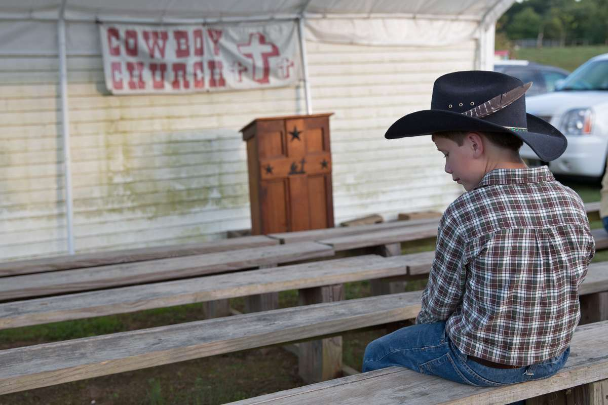 Junior bull rider, John Headley, 10, said he likes to say a prayer before he gets on a bull. (Lindsay Lazarski/WHYY)