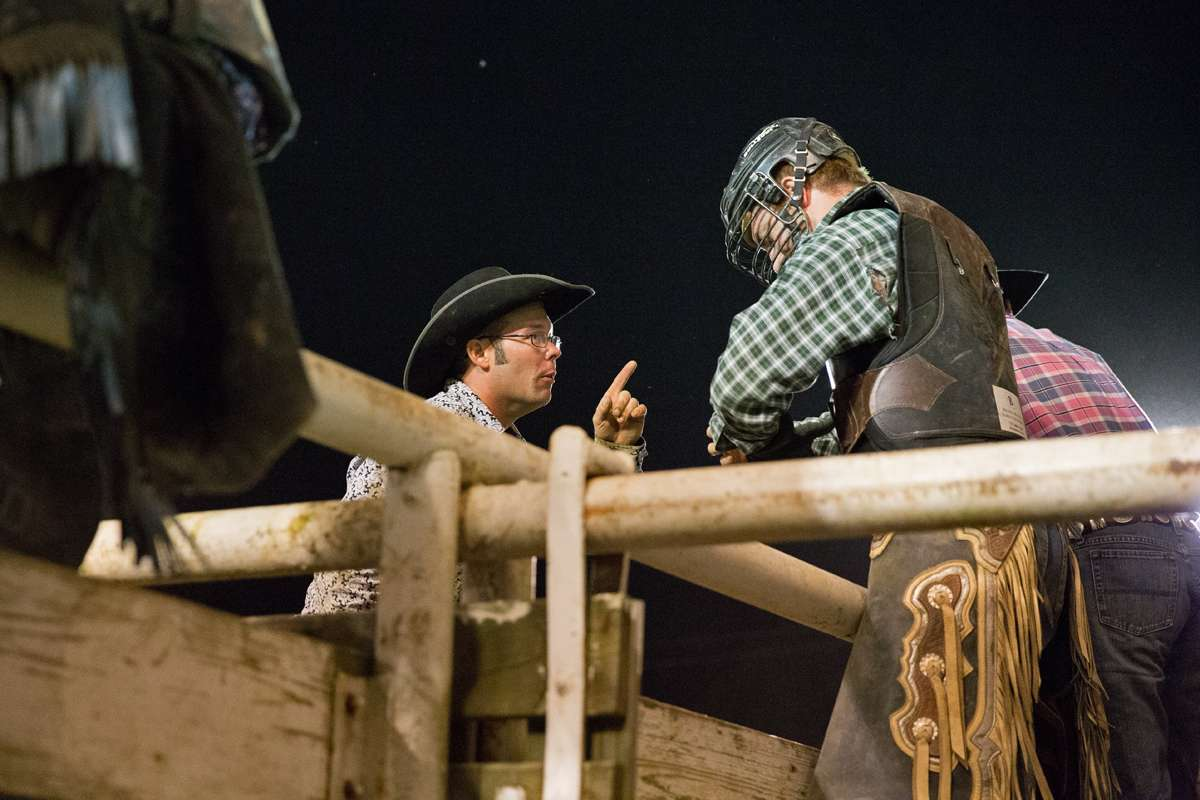 Fellow bull rider Jason Power offers some advice to Mike