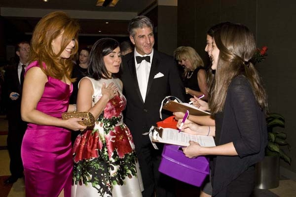 <p><p>Honoree Stephanie Lawrence (center), with Dr. Jennifer Simmons and her husband, Albert, buying grand prize drawing tickets, for a chance to win a Harry Winston watch or a 12-month lease to a 2012 Mercedes-Benz (Photo courtesy of Zoey Sless-Kitain)</p></p>