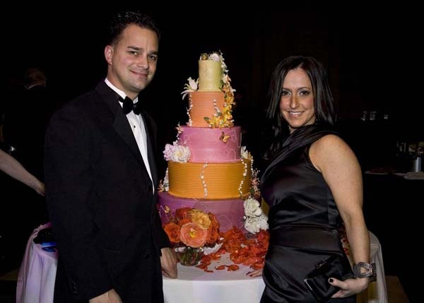 <p><p>Vincent Termini, co-owner of Termini Brothers Bakery, and his wife, Julie with the five-tier butterfly cake donated by Termini (Photo courtesy of Zoey Sless-Kitain)</p></p>