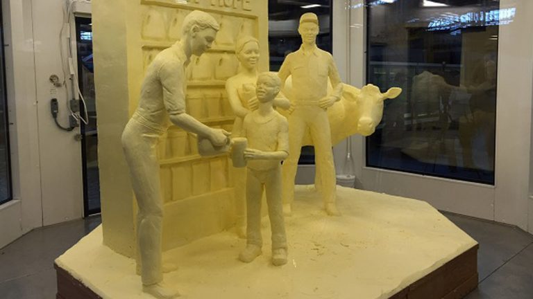 Jim Victor and Marie Pelton of Conshohocken created the massive butter sculpture that's the centerpiece of the Pennsylvania Farm Show. (Mary Wilson/WHYY)