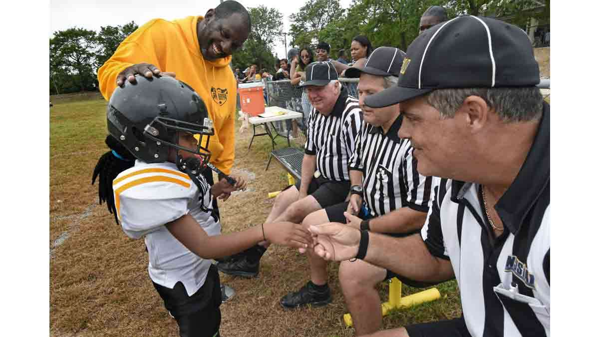 At a Simbas game in September, coach Orlando Council-Pettigrew introduces Janiyah Hill to the referees.