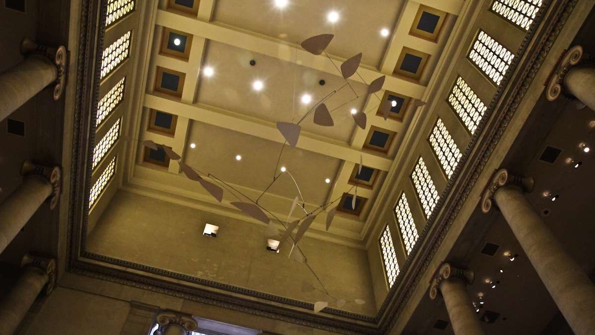 The mobile 'Ghost' hangs in the Great Stair Hall of the Philadelphia Museum of Art. (Kimberly Paynter/WHYY)