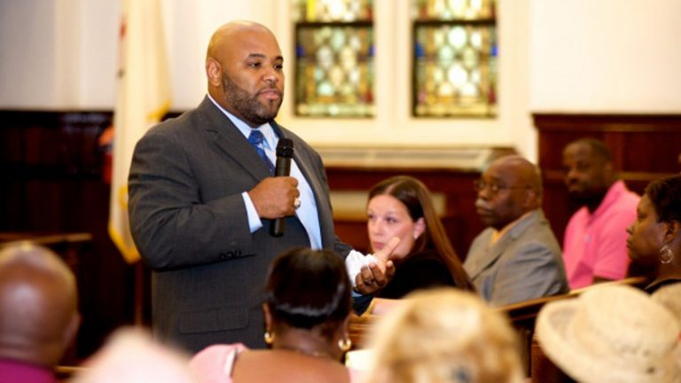 At a public meeting on Wednesday, Principal Milton Alexander pitches Camelot Schools to Germantown community members. (Bas Slabbers/for NewsWorks)