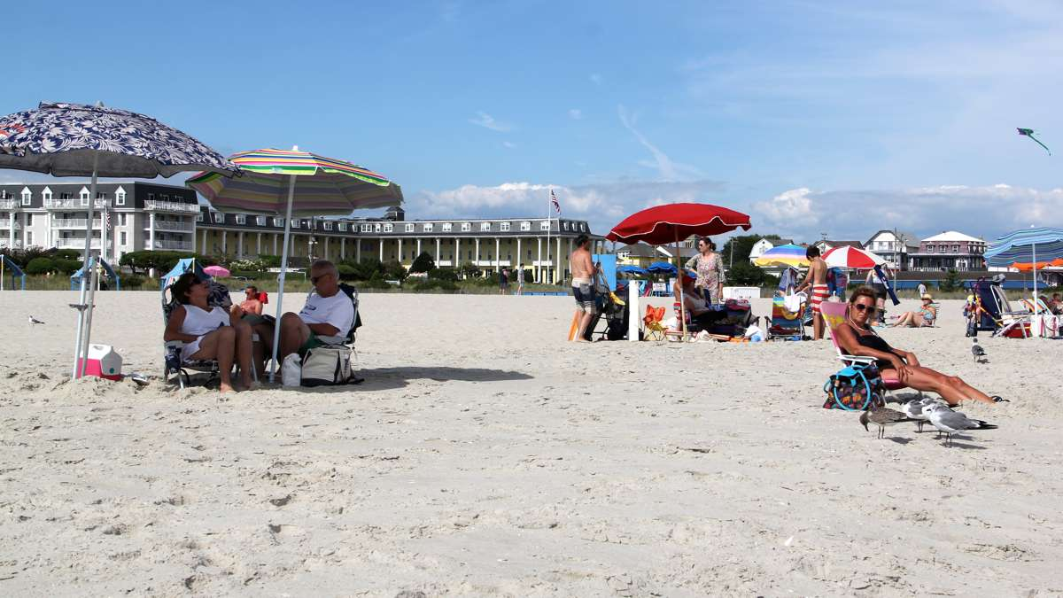 A modern beach scene shows Congress Hall, several blocks to the south of Stockton. (Emma Lee/WHYY)