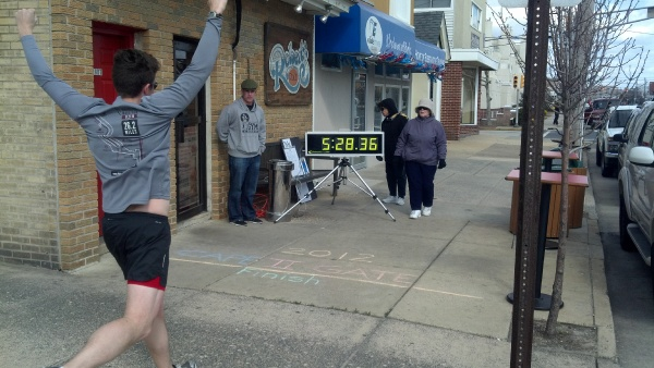 Matt Stanley finishes the relay. The finish line is right at the front door of Roberts Place, host of the after party. (Photo courtesy of Bobb Hawkey)