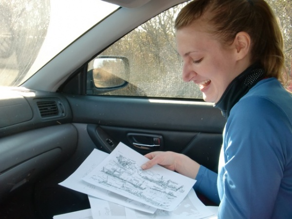 Alison Stuart of Tramps Like Us with sorting through course maps (Photo courtesy of Liz Pagonis)