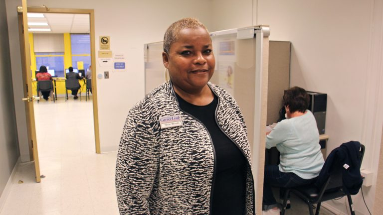 Nicki Woods, site manager of Career Link at Suburban Station, says up to 50 people a day use the facility's dedicated unemployment compensation telephone lines. (Emma Lee/WHYY)