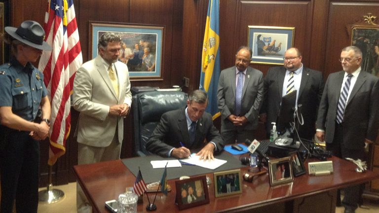 Gov. Carney signed a bill that aims to reduce illicit massage businesses. (Zoë Read/WHYY)