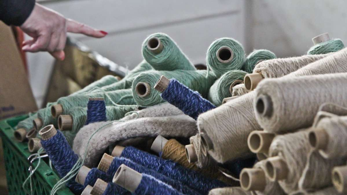 Langhorne Carpet Company gives away more than 5,000 pounds of yarn after a 2013 fire forced the company to get new materials for quality control. (Kimbelry Paynter/WHYY)