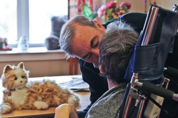 Mark Lipsitt bought a robotic cat for his partner Mary, a nursing home resident who has dementia, to bring her comfort. (Kim Paynter/WHYY)