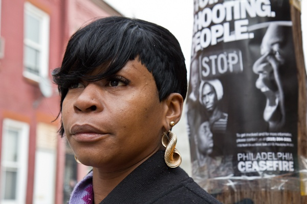 Denise Mickens's cousin was killed in a recent shooting on the block.  She supports the efforts of CeaseFire Philly. (Kimberly Paynter/For NewsWorks)