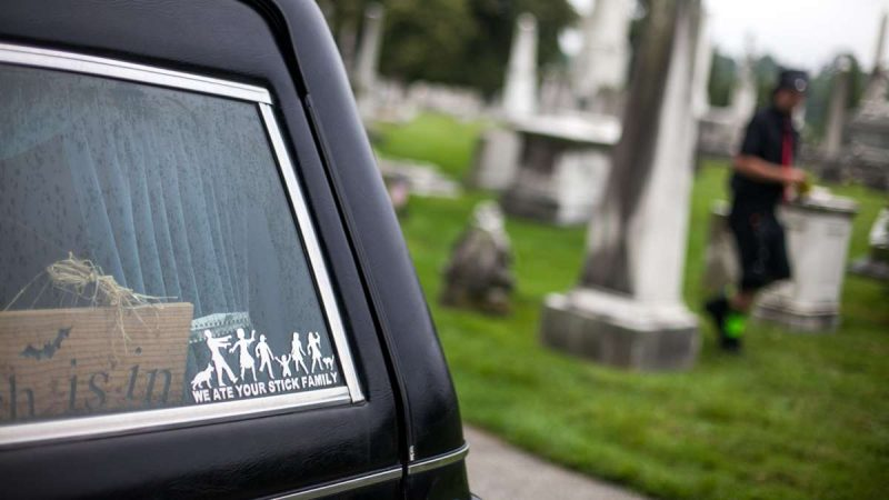 A zombie-themed decal adorns the window of a Cadillac hearse. (Brad Larrison for NewsWorks)