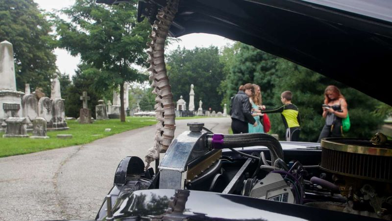 A model of a human spinal cord is used to prop the hood of a 1947 Pontiac Superior hearse. (Brad Larrison For NewsWorks)