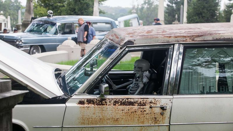 A skeleton sits behind the wheel of a 1977 Cadillac Superior hearse. (Brad Larrison for NewsWorks)
