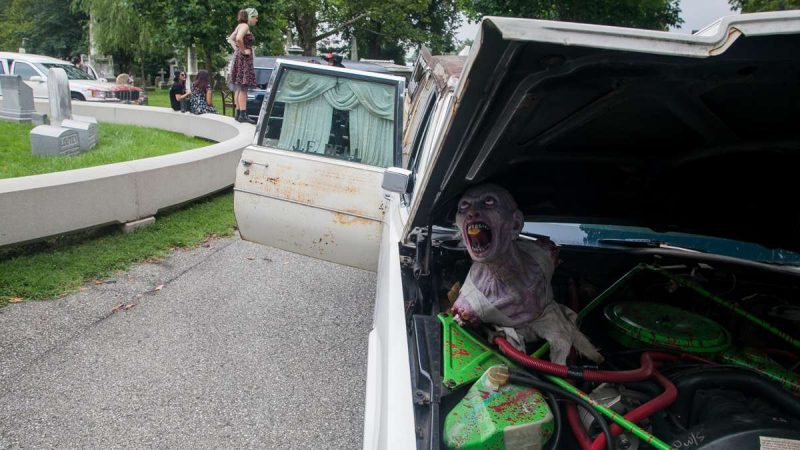 A zombie decorates the engine of a 1977 Cadillac Superior hearse. (Brad Larrison for NewsWorks)