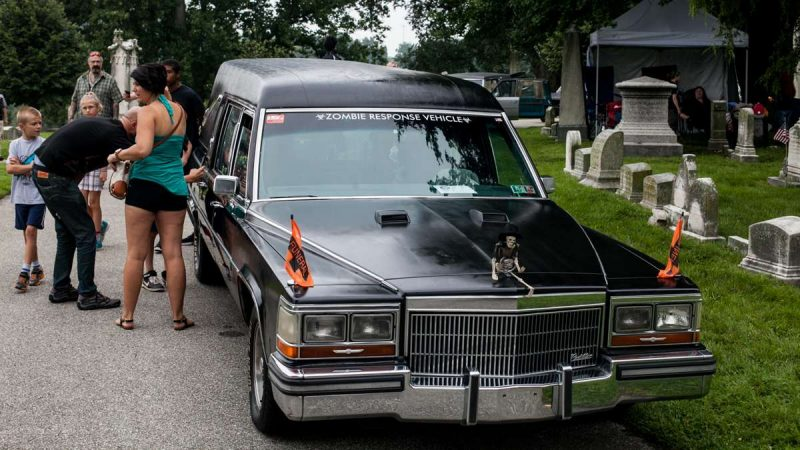 A Cadillac hearse converted into a ''Zombie Response Vehicle,'' draws a crowd at the ninth annual Hearse and Professional Vehicle Show Saturday at Laurel Hill Cemetery. (Brad Larrison for NewsWorks)