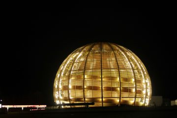 The globe of the European Organization for Nuclear Research, CERN, is illuminated outside Geneva. In 2010 scientists at the world's largest physics lab clocked subatomic particles, called neutrinos, traveling faster than light, breaking a fundamental pillar of science. (AP Photo/Anja Niedringhaus, file)