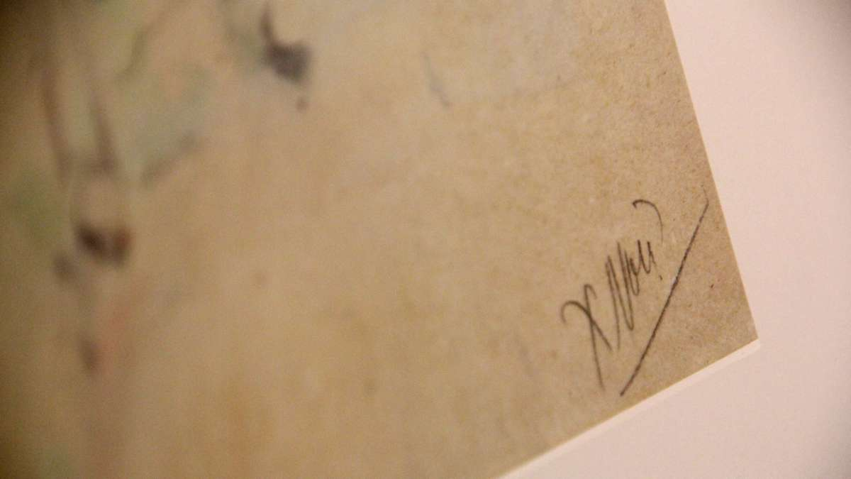 Notes on the paper were likely made by a dealer or framer. This one appears to read 'X non.' (Emma Lee/WHYY)