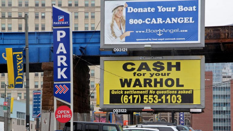 Signs popping up around Drexel offering you cash for your Warhol are the work of Boston artist Geoff Hargadon. (Emma Lee/WHYY)