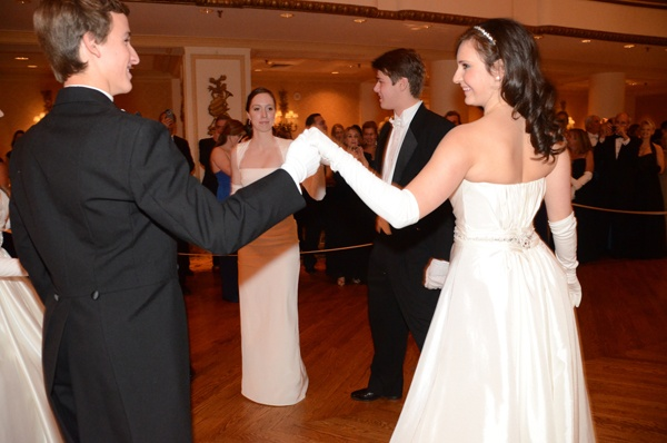 <p>&lt;p&gt;Michael Mathew Maggio (left), Young Ladies&#x2019; Committee member Courtney Elizabeth McGill, Mr. Benjamin Magaziner Sheppard, and&#xA0;debutante Laura Katerina McCauley perform a formal cotillion during their presentation (Photo courtesy of Sabina Louise Pierce)&lt;br /&gt;&lt;br /&gt;&lt;/p&gt;</p>