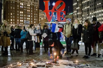 People are shown gathering on Jan. 9, 2015, at JFK Plaza  in Philadelphia, to pay tribute to victims of the terrorist attack against the French satirical weekly Charlie Hebdo. (AP Photo/Matt Rourke)
