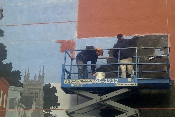 <p>&lt;p&gt;Last week, artists took the wall and applied pre-painted panels to serve as a base for the mural. (Brian Hickey/WHYY)&lt;/p&gt;</p>