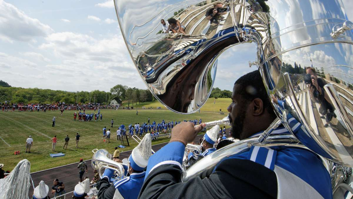 Members of the Cheyney marching band play in the stands. Historically black colleges like Cheyney enroll 8 percent of African-American college students, but their graduates make up 21 percent of African-Americans getting diplomas. (Bastiaan Slabbers/for NewsWorks)