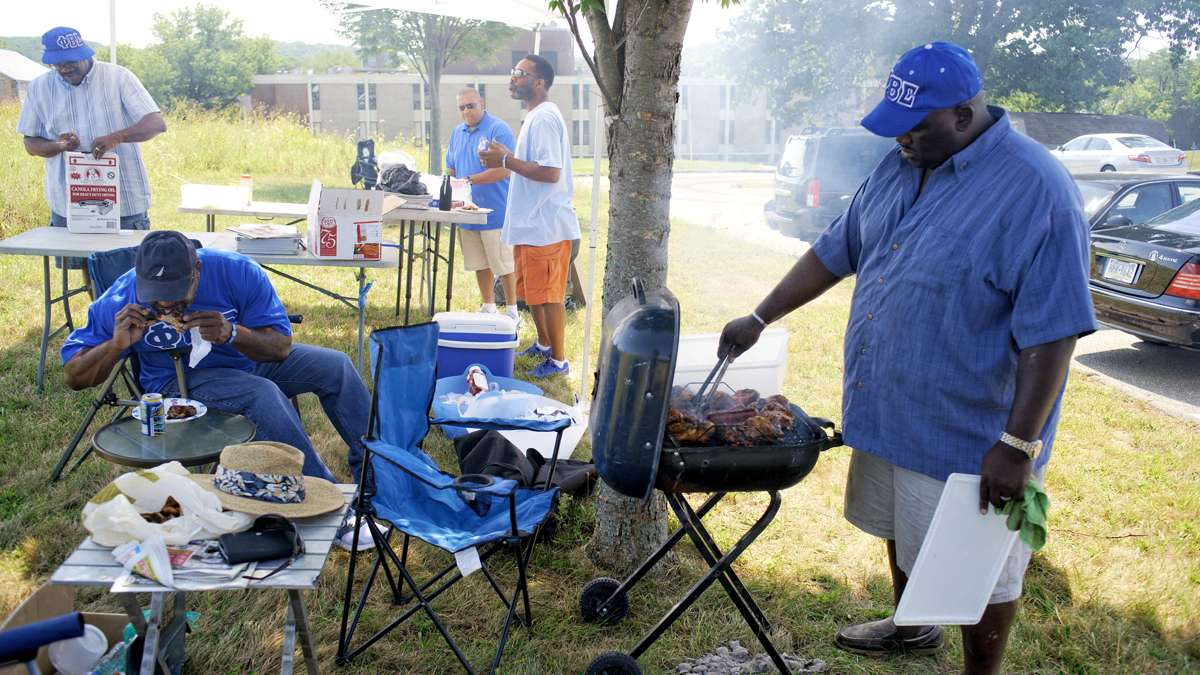 Cheney University alumni take part in a tailgating party ahead of the 'Battle of the Firsts' football game between the Cheyney Wolves and Lincoln University Lions, in September at the Cheyney campus. (Bastiaan Slabbers/for NewsWorks)