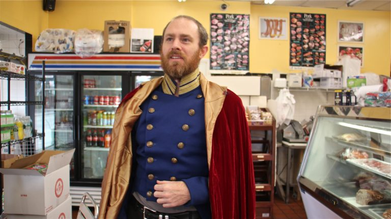 Chris Davis returns to the Italian Market butcher shop where last winter he staged a one-man play about the Mexican-American War. This time, he depicts the life of Mexico's last emperor, Maximilian I. (Emma Lee/WHYY)