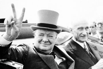 Former British Prime Minister Winston Churchill, gives his famous V-sign, as he drives through cheering inhabitants of the town of Metz, in France, on July 14, 1946. (AP Photo)