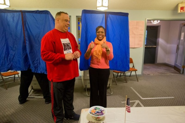 "<p><div style=""margin: 0px; font: 10px 'Lucida Grande';""><span style=""font-size: 12pt;"">Armstead King, judge of elections, watches as Eighth District City Councilwoman Cindy Bass exits the voting booth after casting her ballot at Germantown Christian Academy. (Dave Tavani/ for NewsWorks)</span></div></p>"