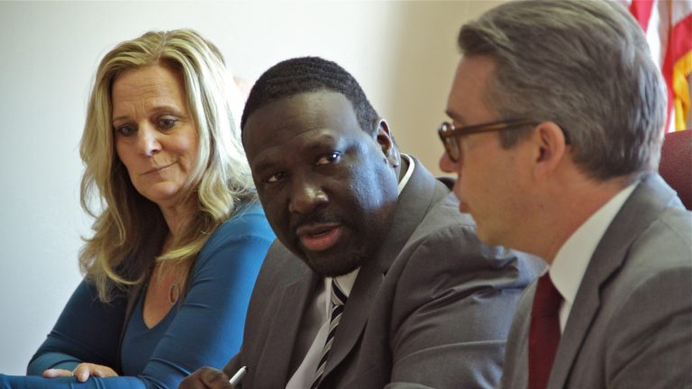 Anthony Clark (center) was re-elected chair of the Philadelphia City Commissioners by fellow commissioners Lisa Deeley (left) and Al Schmidt (right). (Emma Lee/WHYY)