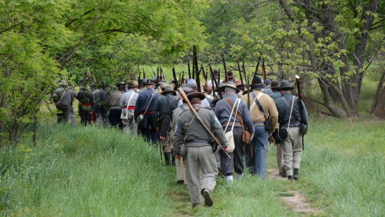 The Confederate Army marches into a reenactment of the Battle of Kernstown, Virginia. (Max Matza/NewsWorks)