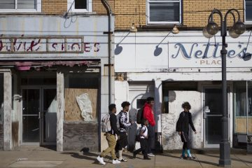 Kids walk down Miller Avenue passed shuttered businesses in downtown Clairton, Pennsylvania. (Jessica Kourkounis/For Keystone Crossroads)