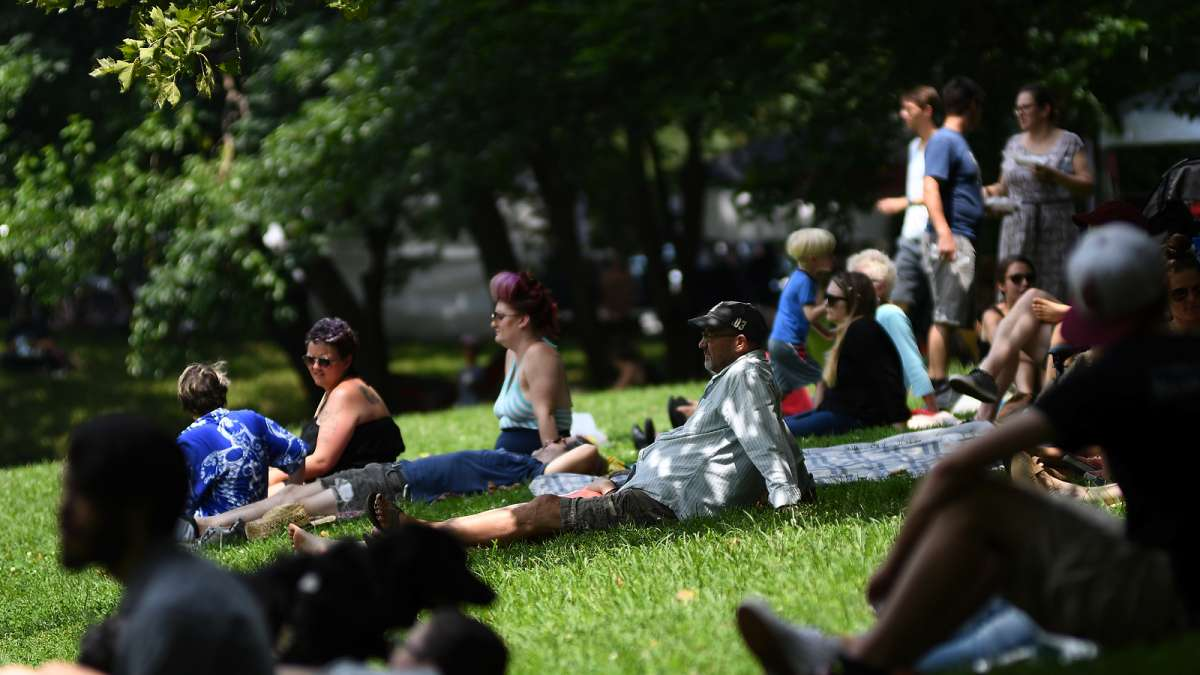 The trees lining the wide grass field provide plenty of shade for fans of one of the acts taking center stage at the annual Clark Park Festival, in West Philadelphia