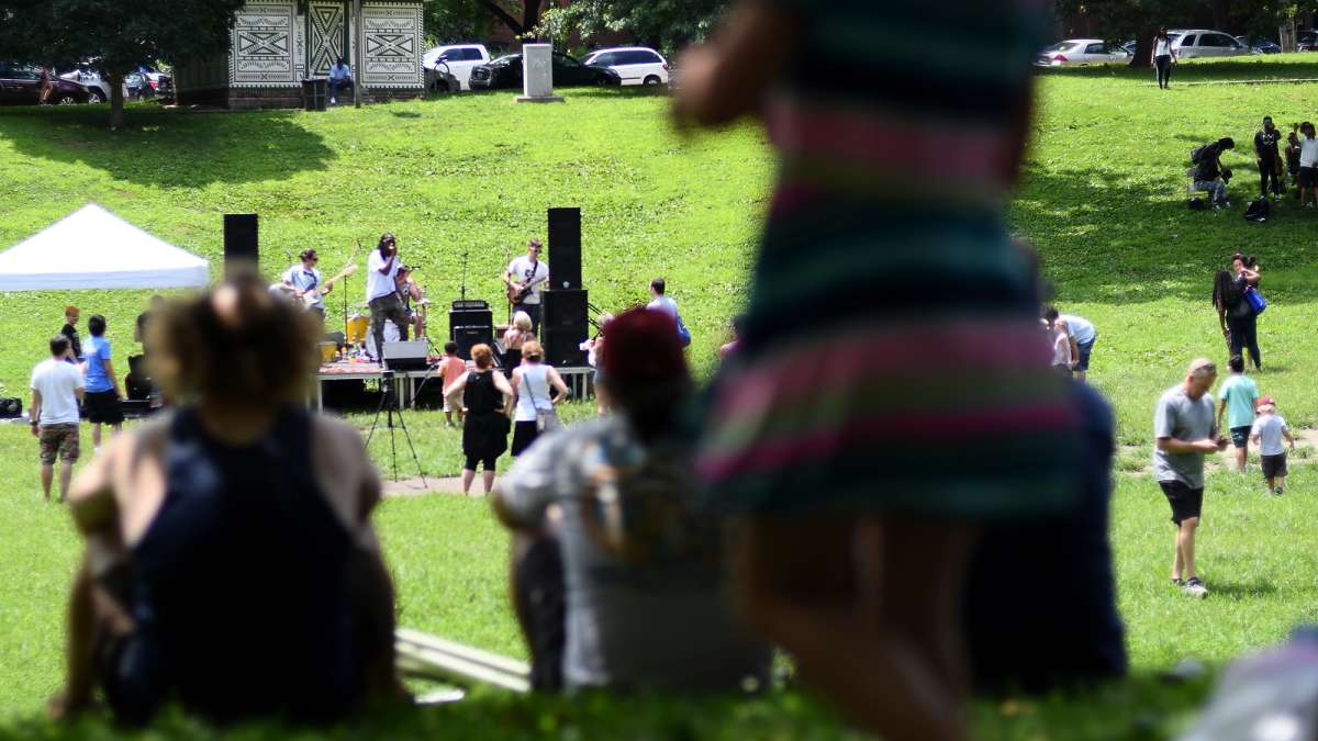 The trees lining the wide grass bowl provide plenty of shade for fans of one of the acts taking center stage at the annual Clark Park Festival