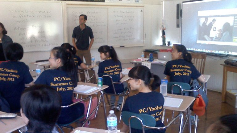 Penn Charter teacher Jim Fiorile leads Tianjin students through a lesson on idioms. (Carrie Hagen/for NewsWorks)