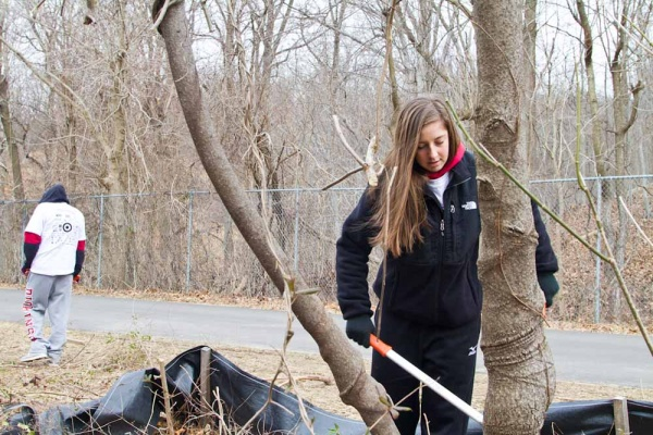<p>&lt;p&gt;Kerrie Courtman, a volunteer and student form St. Joe's University, helps clear up growth along The Schuylkill River Bike Trail. (Brad Larrison/For NewsWorks)&lt;/p&gt;</p>