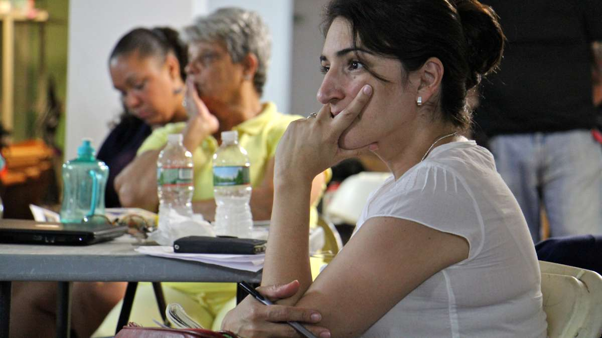Patricia Codina, community development director at Impact Services, attends a meeting to discuss the Guerney Street clean up project. (Emma Lee/WHYY)