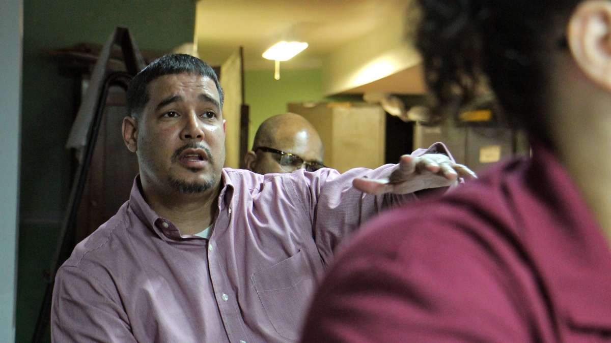 Pastor Joey Crespo of Victory Outreach men's recovery home talks about the services that will be needed as the Gurney Street heroin camp is cleaned up. (Emma Lee/WHYY)
