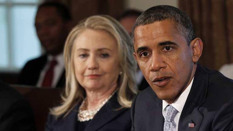 Then-Secretary of State Hillary Rodham Clinton is shown in 2012 listening to President Barack Obama speak to members of the media during a Cabinet Meeting in the Cabinet Room of the White House. (AP Photo/Pablo Martinez Monsivais)
