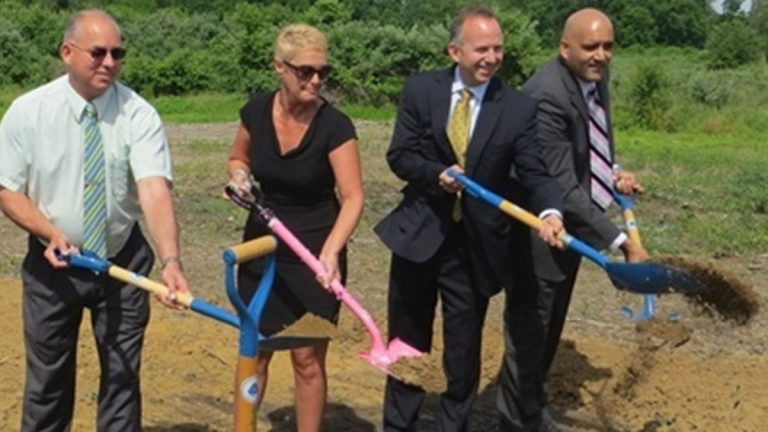 Jennifer Cohan, seen here holding a pink shovel during a DMV groundbreaking ceremony in June 2013, has been nominated to be DelDOT's next secretary. (Mark Eichmann/WHYY)