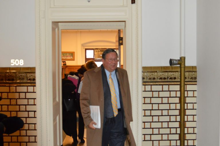 Comcast's David Cohen emerges from Councilman Bill Greenlee's office after a meeting (Tom MacDonald, WHYY)
