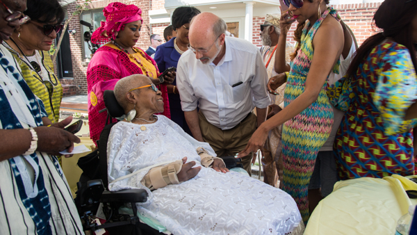 Lois Fernandez, 80, who helped to found the celebration of African culture in 1975, talks with Pennsylvania Gov. Tom Wolf at the 42nd Annual Odunde Festival.