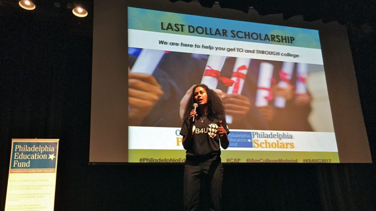 Dolores Adriaanse with the Philadelphia Education Fund prepares to present first-generation college students with scholarships at the Know Before You Go event. (Avi Wolfman-Arent/WHYY)