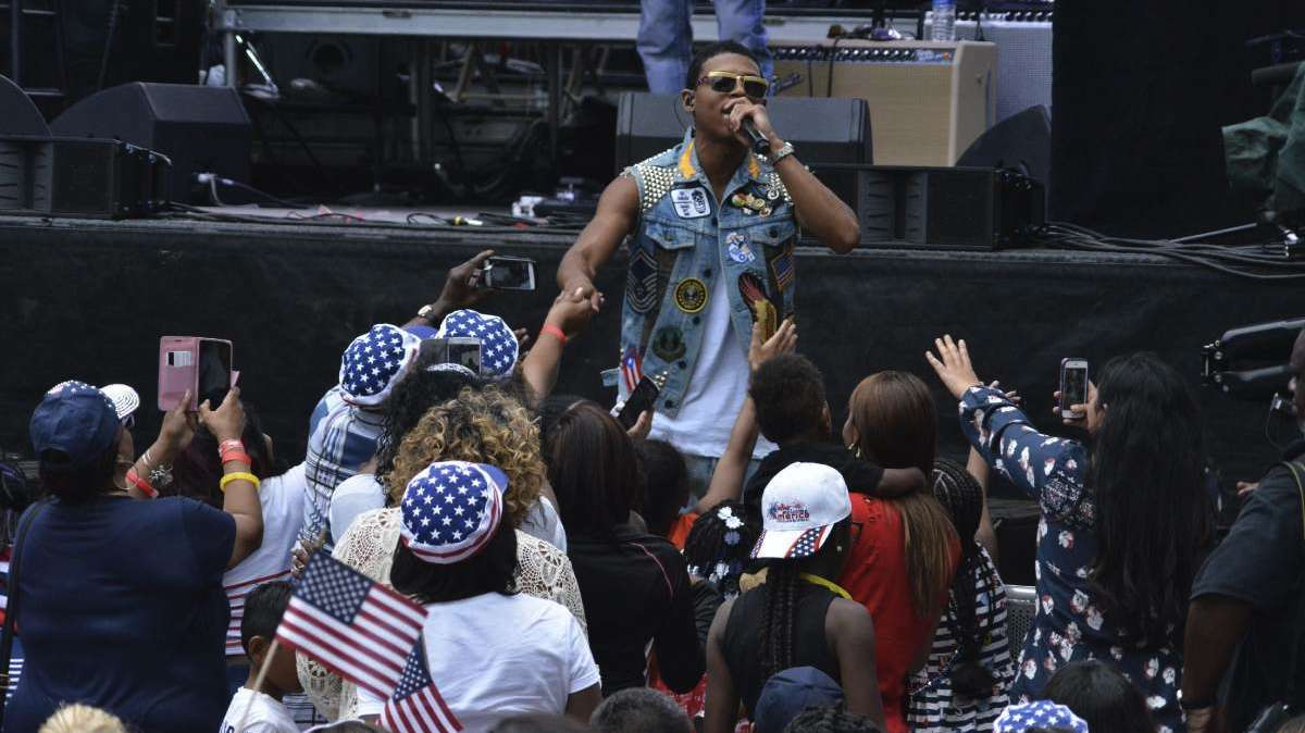 Yazz the Greatest greets fans off-stage as he performs during the Wawa Welcome America concert.