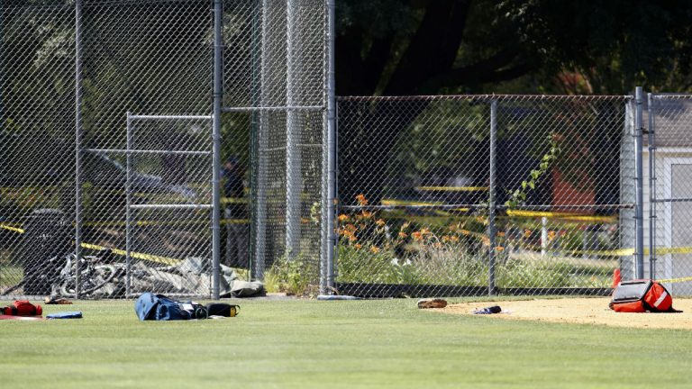 Equipment and medical bags are seen on the baseball field in Alexandria, Va., Wednesday, June 14, 2017, after a shooting where House Majority Whip Steve Scalise of La., and others were shot during a congressional baseball practice. (AP Photo/Alex Brandon)