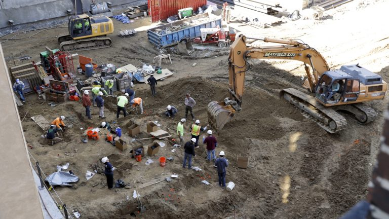 Workers excavate coffins from a construction site in the Old City neighborhood March 9 in Philadelphia.   (Matt Slocum/AP Photo)